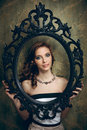 Pretty woman holding an empty frame Royalty Free Stock Photo