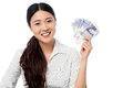 Pretty woman holding a fan of currency notes showing british pound isolated over white background Stock Image