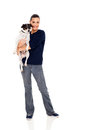 Pretty woman holding her per dog white background Royalty Free Stock Photo