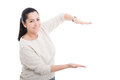 Pretty woman holding something in her palms Royalty Free Stock Photo
