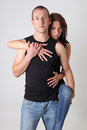 Pretty woman hugging her boyfriend Stock Photography