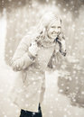 Pretty woman laughs in the christmas snow Royalty Free Stock Images