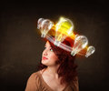 Pretty woman with light bulbs around her head preety circleing Royalty Free Stock Photo