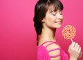 Pretty woman with lollipop over pink background Stock Image