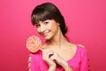 Pretty woman with lollipop over pink background Royalty Free Stock Photos