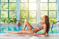 Pretty woman lying on the edge of the pool Stock Images