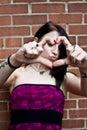 Pretty Woman Making a Heart Royalty Free Stock Photo