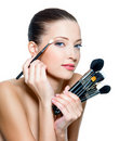 Pretty  woman making make-up around the eyes. Royalty Free Stock Images