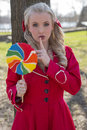 Pretty woman making silence sign blond candy girl and holding a big colorful lollipop Stock Photos