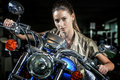 Pretty woman on motorcycle at night beautiful female model portrait with over time background Royalty Free Stock Image