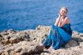 Pretty woman near the sea Royalty Free Stock Photo
