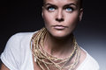 Pretty woman with necklace of gold rope Royalty Free Stock Photo