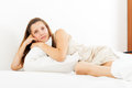 Pretty woman in nightrobe on bed at bedroom Stock Photography