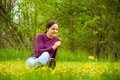 Pretty woman oudoor on grass with flowers Stock Images