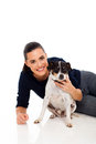 Pretty woman playing her dog isolated white background Stock Image