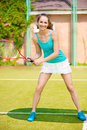 Pretty woman playing tennis and waiting for the service Royalty Free Stock Photography