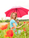 Pretty woman in poppy field Stock Photos
