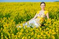 Pretty woman portrait in vivid rape field Stock Images