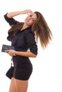 Pretty woman with purse and wallet standing in black dress Stock Image