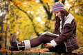 Pretty woman reading book and smiling young a in the park Royalty Free Stock Images