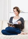 Pretty woman reads the book Royalty Free Stock Image
