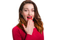 Pretty woman in red looking away in awe surprised with mouth ope open wide isolated on white background Stock Photos
