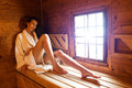 Pretty woman relaxing in a hot sauna Stock Photo