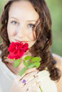 Pretty Woman with a rose Stock Images