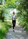 Pretty woman running in the park Royalty Free Stock Images