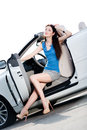 Pretty woman sits in the cabriolet with door opened sunglasses white car side Stock Image