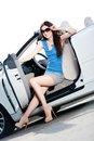 Pretty woman sits in the car with side door opened sunglasses white Royalty Free Stock Photo