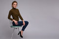 Pretty woman sits on chair Royalty Free Stock Photo