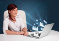Pretty woman sitting at desk and typing on laptop with diagrams Stock Photos
