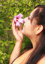 Pretty Woman Smelling Flower Royalty Free Stock Image