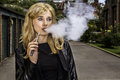 Pretty woman smoking an e-cigarette Royalty Free Stock Photo