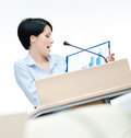 Pretty woman speech maker at the podium Stock Photography