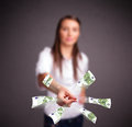 Pretty woman standing and throwing money young Royalty Free Stock Photos
