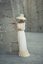 Pretty woman in straw hat beautiful young lady the palace Stock Image