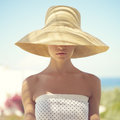 Pretty woman in straw hat beautiful young lady the sunlight Royalty Free Stock Photography