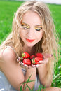 Pretty woman with strawberry Stock Photos