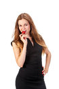 Pretty woman with strawberry in hand Royalty Free Stock Photo