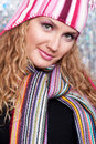 Pretty woman in striped scarf and hat Stock Photos
