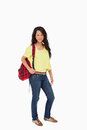 Pretty woman student posing with a backpack Stock Image