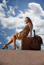Pretty woman with suitcase and guitar Royalty Free Stock Images