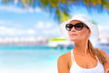 Pretty woman on summer holidays closeup portrait of standing seashore and looking into the distance enjoying beach resort maldives Stock Photo