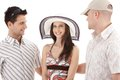 Pretty woman surrounded by men Royalty Free Stock Photography