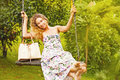 Pretty woman on a swing Royalty Free Stock Photo