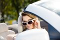 Pretty woman taking sunglasses off in the car Royalty Free Stock Photo