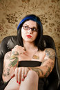 image photo : Pretty Woman with Tattoos in a Leather Chair