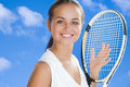 Pretty woman with a tennis racket Stock Photography